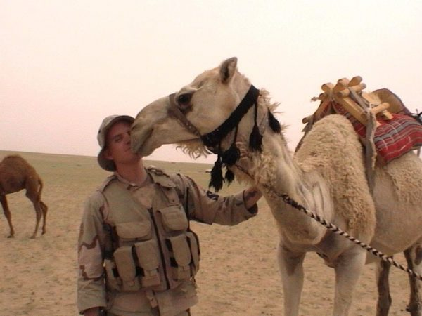 soldier (Time Milbrodt) in the desert with a camel